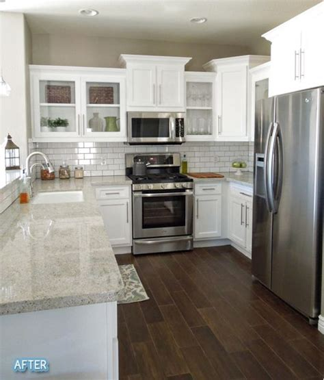 white kitchen cabinets with dark hardwood floors before after upgrading a builder s grade kitchen