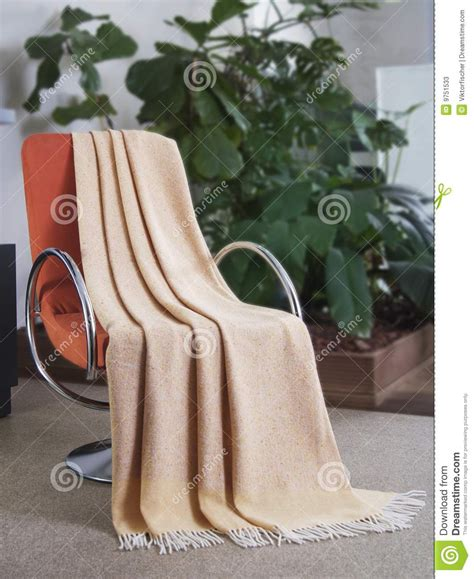draped over throw draped over a chair stock image image of nobody