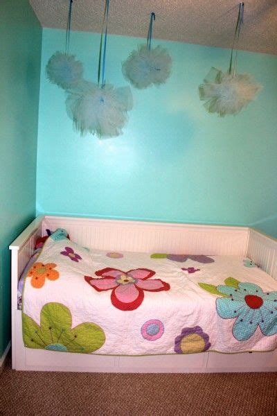 Pom Poms To Hang From Ceiling by Decorative Tulle Pom Poms Hanging From The Ceiling Are A