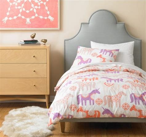 Dwell Studio Lighting the friendly unicorn peony duvet set