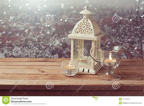 l and lantern village vintage lantern with over winter town background