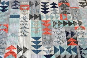 quilt triangle on flying geese quilt