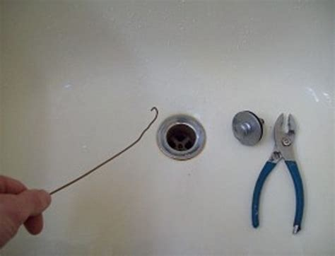 cleaning out bathtub drain how to clean bathtub drain clogged with hair 6 steps