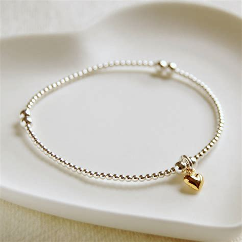 delicate silver bead bracelet with tiny gold heart by highland angel   notonthehighstreet.com