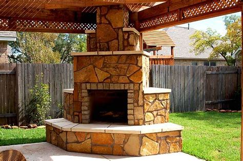 indulge in the many benefits of an outdoor fireplace by