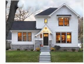 white siding black roof grey brick home