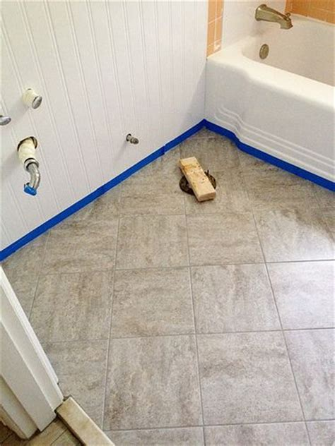 stick on tiles bathroom remodelaholic bathroom redo grouted peel and stick