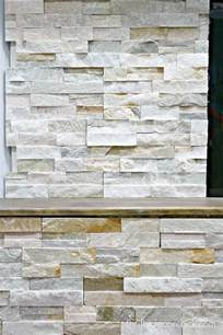 how to install stacked stone tile on a fireplace wall from thrifty decor chick
