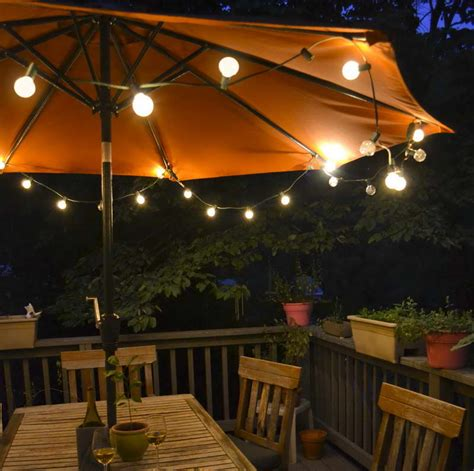 Solar Patio String Umbrella Lights 27 Ideas For Decorating Patio With Lighting Fixtures Interior Design Inspirations