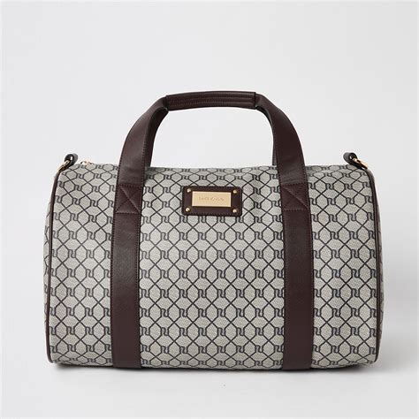 brown ri monogram print weekend bag suitcases bags