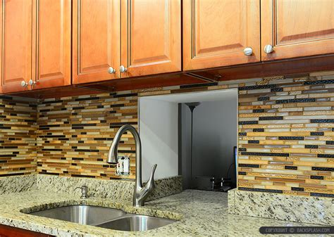 brown kitchen cabinets with new venetian gold granite