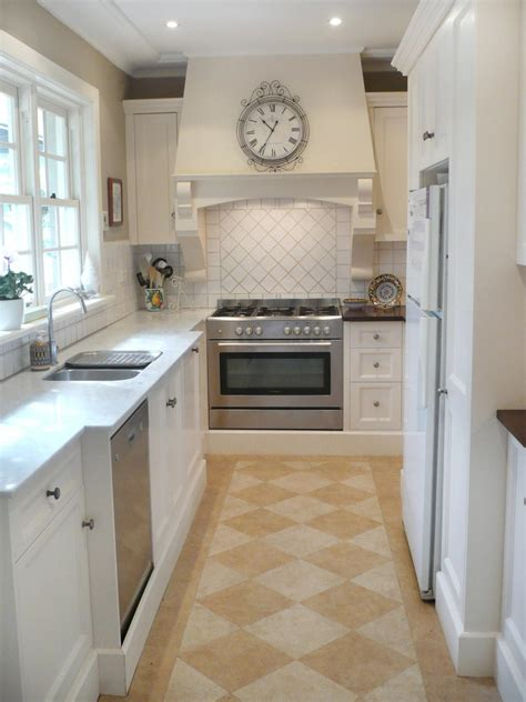 superb Narrow Galley Kitchen Design Ideas #4: RMS_ginagypsy-white-neutral-french-country-narrow-kitchen_s3x4.jpg.rend.hgtvcom.1280.1707.jpeg