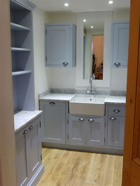 parma gray for the utility cupboards and a belfast sink farrow and parma