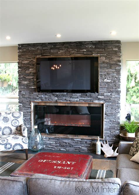 rustic ledgestone fireplace reclaimed wood surround tv top hunting inspired decor gray sectional kylie interiors