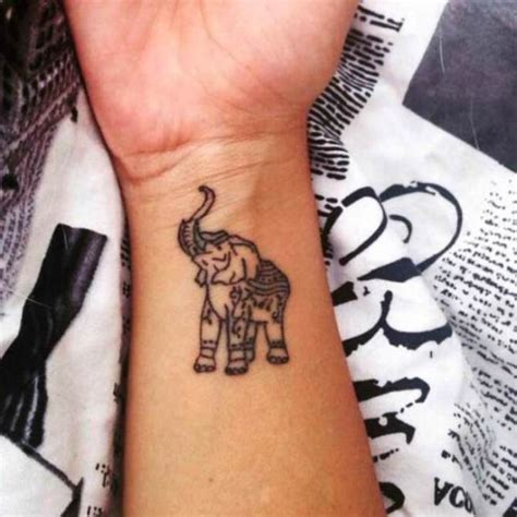 elephant tattoo with trunk up meaning 46 elephant tattoos on wrists