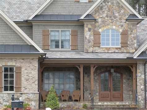 Natural stone, shake, shutters, metal roofing   Craftsman
