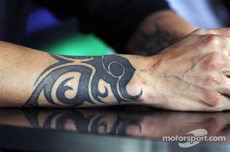 a tattoo on the arm of kimi raikkonen lotus f1 team in
