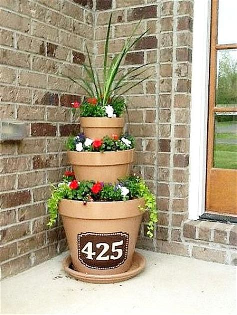 Tower Planter Pots by 10 Amazing Flower Tower Tipsy Pot Planter Ideas