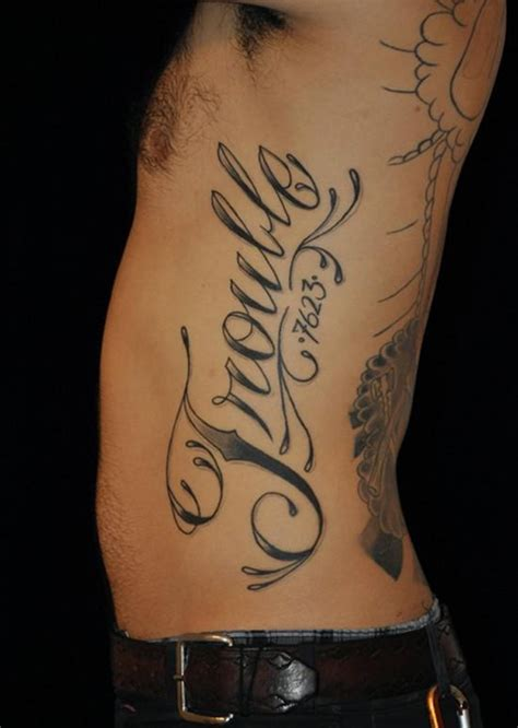 men side tattoos rib cage name idea