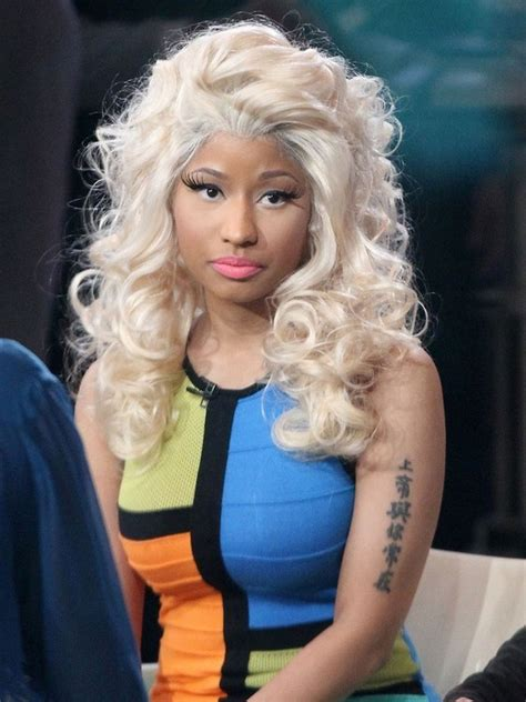 nicki minaj s tattoos lettering tattoo on upper arm