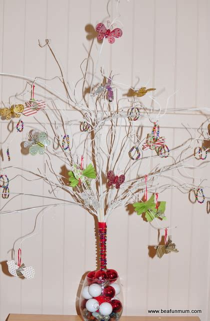 twig tree home decorating christmas table decorations baubles in a vase or bowl