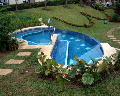 sloped backyard pool freeform swimming pool designs and shapes