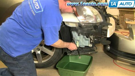 install replace windshield washer pump nissan