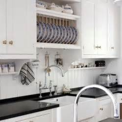 beadboard backsplash kitchen kvanum kitchens white kitchen cabinets glossy black quartz countertops farmhouse sink