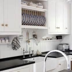 Beadboard Backsplash Kitchen Kvanum Kitchens White Kitchen Cabinets Glossy Black Quartz Countertops Farmhouse Sink