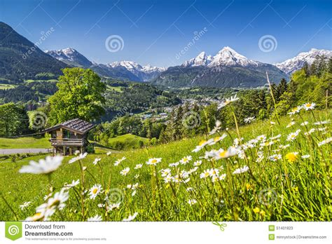 Vacation Cabin Plans idyllic landscape in the alps in spring with traditional