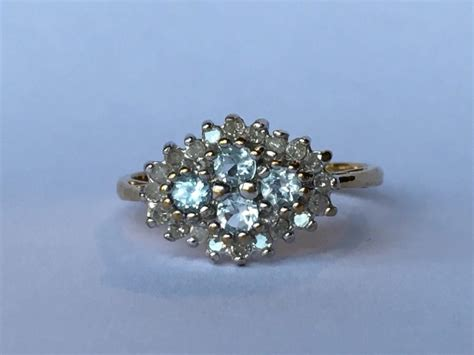 vintage blue topaz and cluster ring in 9k yellow