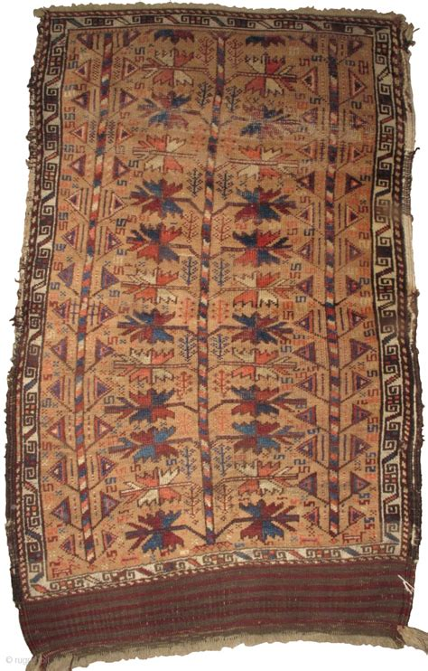 camel ground baluch tree rug with a central classic type