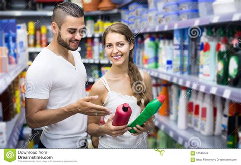 people who buy houses people buying detergents in the shopping mall stock image