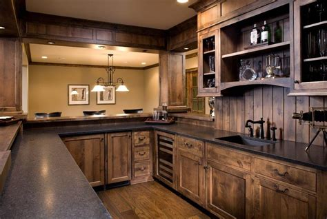stained wood kitchen cabinets knotty alder dark stain entry transitional with hanging