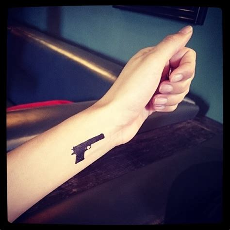 rihanna gun tattoo watson channels rihanna with new gangsta gun
