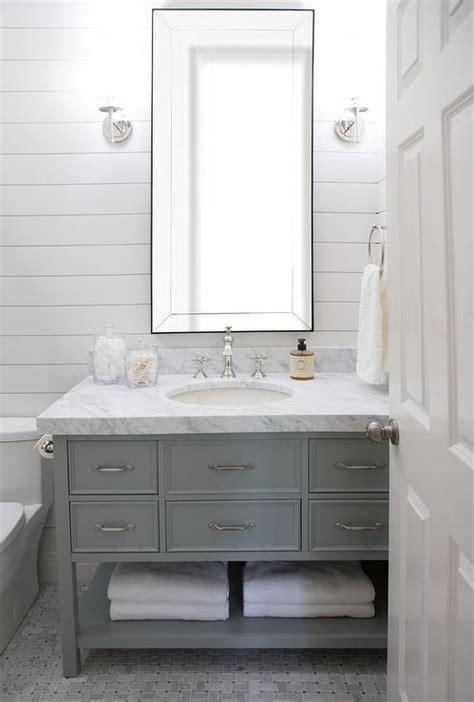 beveled vanity mirror hangs  polished nickel