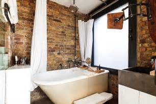 Rustic Bathroom Decor - exposed brick walls meet sustainable modern design in splendid london apartment