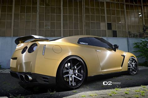nissan gtr matte black gold rims matte gold nissan gtr d2forged cv8 wheels three quarter