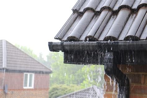 longlife roofing and guttering hanging gutters on metal roof
