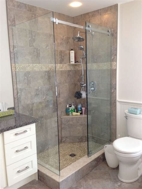 finished shower with river rock bathroom ideas
