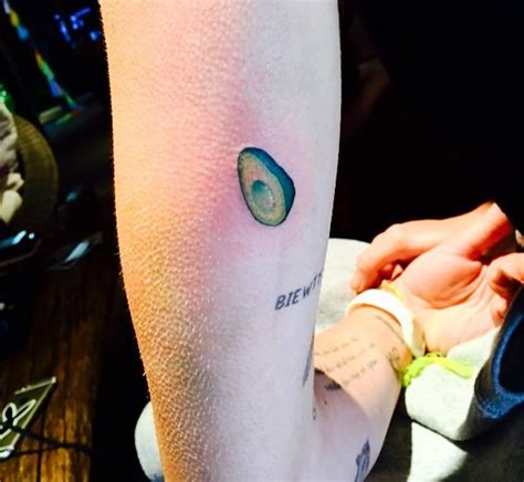 miley cyrus reveals new avocado arm tattoo on instagram