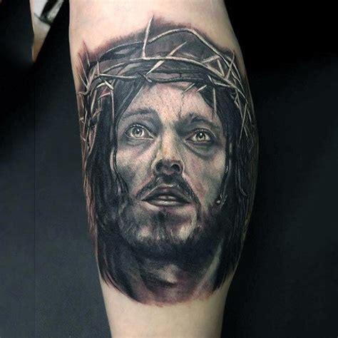 jesus tattoo on his thigh gentleman with jesus christ face tattoo on leg calf