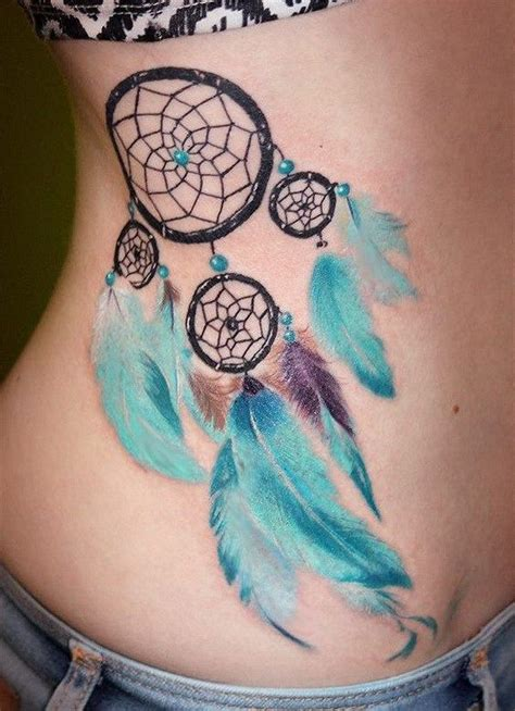 soft tattoo designs catcher design with soft blue feathers