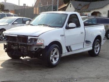 purchase   ford   svt lightning damaged salvage   miles rare supercharged