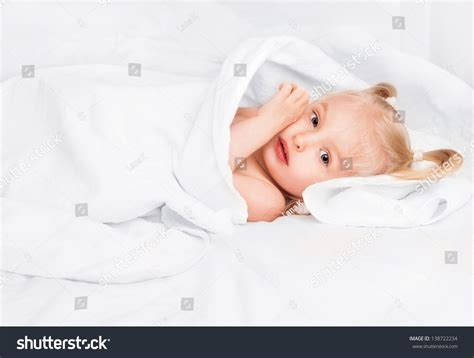 taking bath after c section cute two year old girl wrapped into towels after taking a