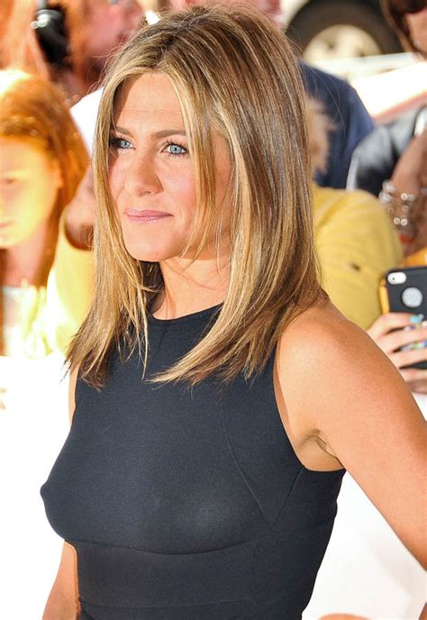 Jennifer Aniston falls victim to flashbulbs going braless at TIFF Cake premiere   Daily Star