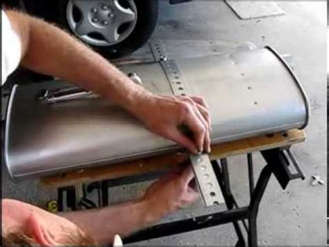how to replace the muffler on a 2000 dodge grand caravan