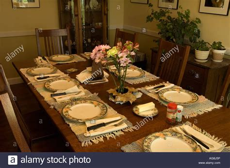 dining room table set up for meal stock photo royalty