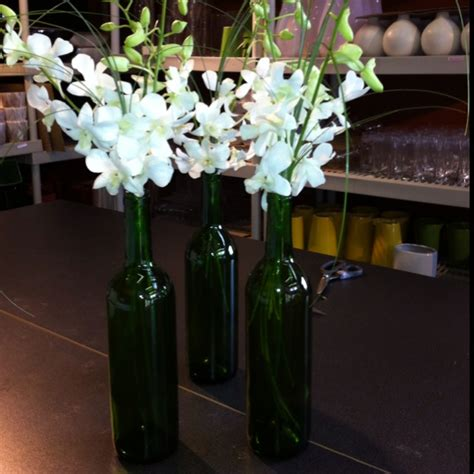 wine bottle centerpieces for weddings wine bottle centerpieces with dendrobium orchids i made these for my wedding last summer
