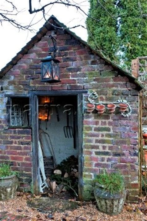 she shed cost lit lantern on brick wood shed in walberton west sussex